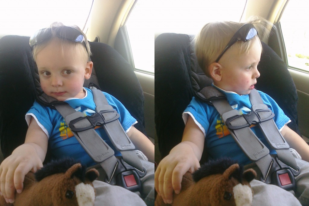 Marshall at 2 years old wearing sunglasses in his car seat
